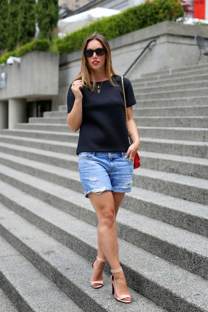 minimalist top and distressed shorts