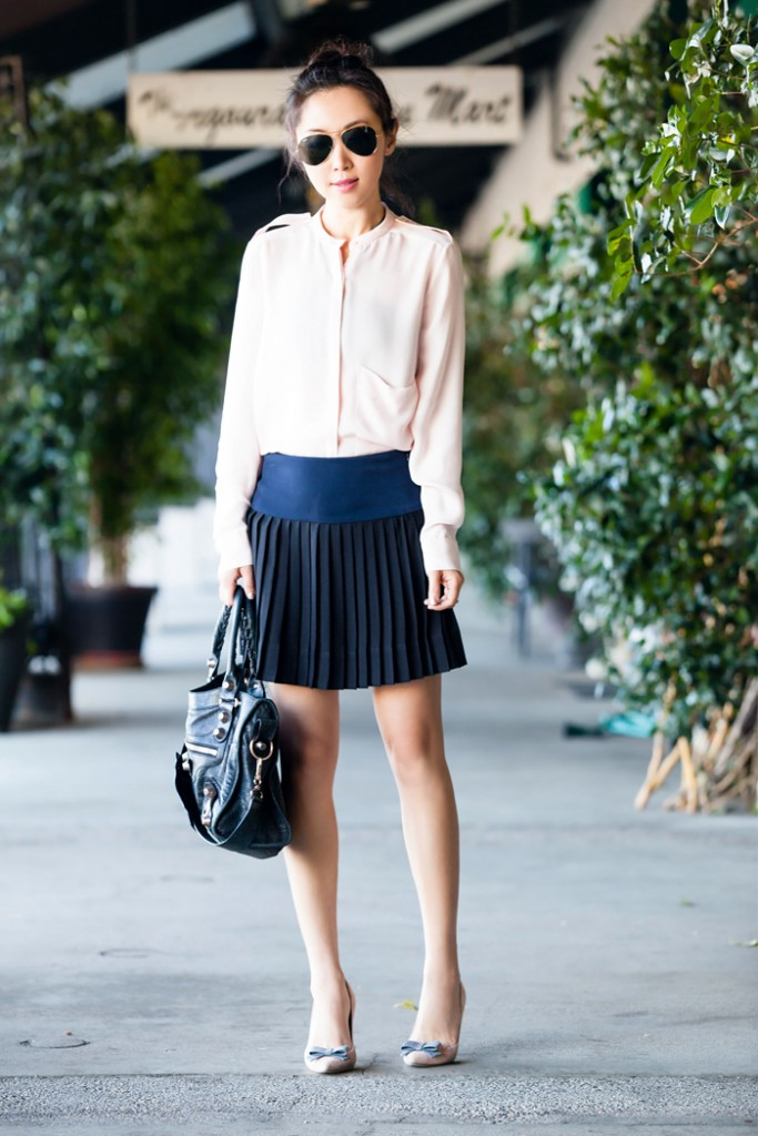 silk blouse and pleated skirt