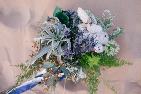 blue non-floral bouquet - photo by Ashley Williams Photography http://ruffledblog.com/california-sand-dunes-wedding