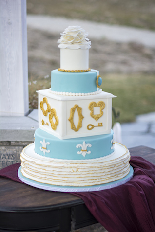 Blue, gold, and white wedding cake | Alisha Khan Photography | see more on: http://burnettsboards.com/2015/05/romance-chivalry-medieval-inspiration-shoot/