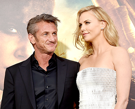 Engaged couple Sean Penn and Charlize Theron cozied up at the premiere of Warner Bros. Pictures'