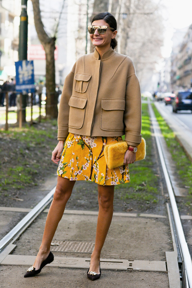 yellow floral skirt and brown coat