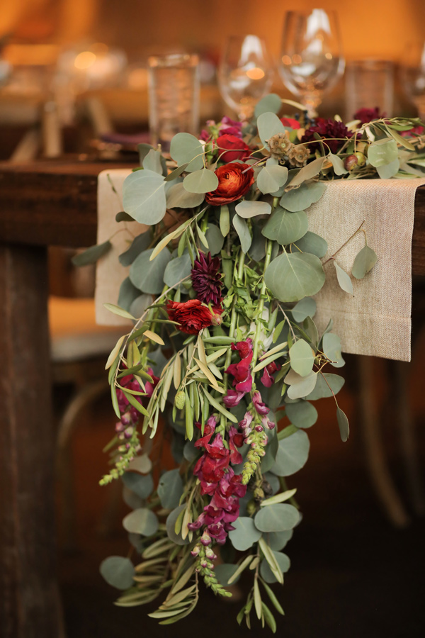 eucalyptus table runner - photo by Pepper Nix Photography http://ruffledblog.com/deer-valley-resort-wedding-with-a-burgundy-gown