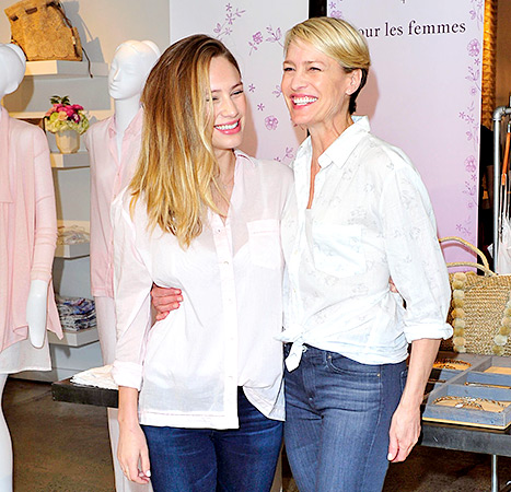 Look-alike mother-daughter duo Robin Wright and Dylan Penn share a laugh at Wright's Pour Les Femmes sleepwear launch in L.A. on May 9.