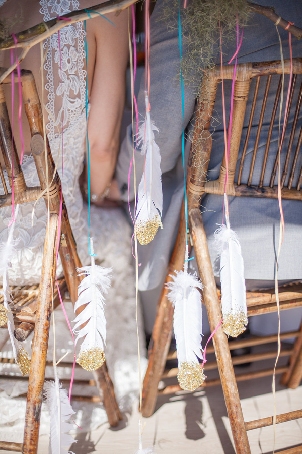 glitter dipped feathers - photo by Samantha McFarlen http://ruffledblog.com/seattle-watercolor-wedding-editorial