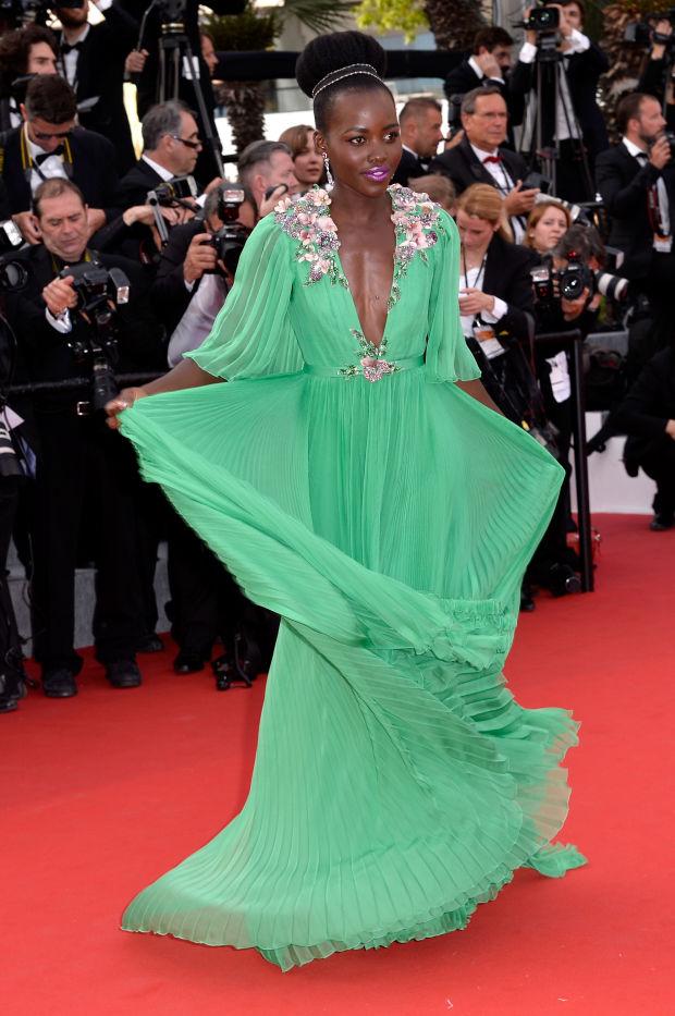 Lupita Nyong'o in a green Gucci gown.