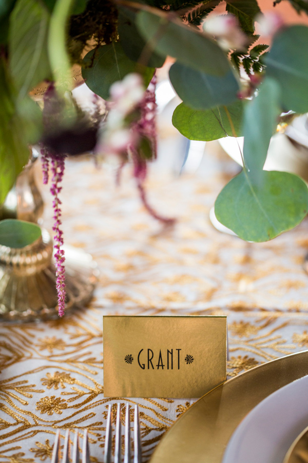 gold name card - photo by Krista Esterling Photography http://ruffledblog.com/modern-meets-1920s-wedding-editorial