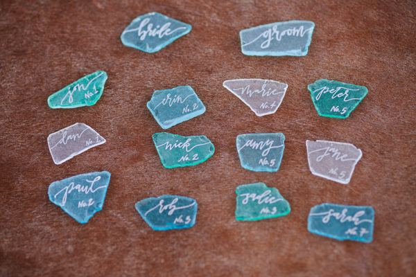 sea glass escort cards - photo by Ashley Williams Photography http://ruffledblog.com/california-sand-dunes-wedding