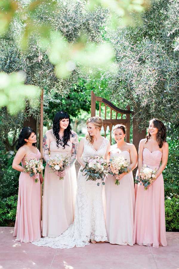 pink bridesmaid dresses - photo by Pinkerton Photography http://ruffledblog.com/spring=romantic-wedding-in-the-desert