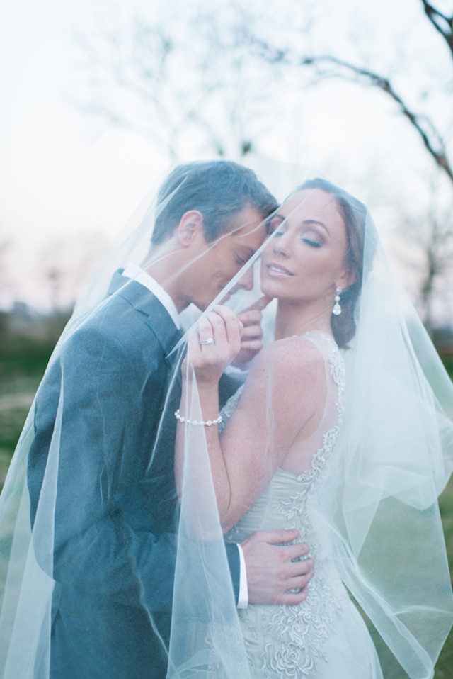Kissing under the veil | Elisheva Golani Photography and Belle Soul Weddings | see more on: http://burnettsboards.com/2015/05/romantic-dusty-blue-wedding/