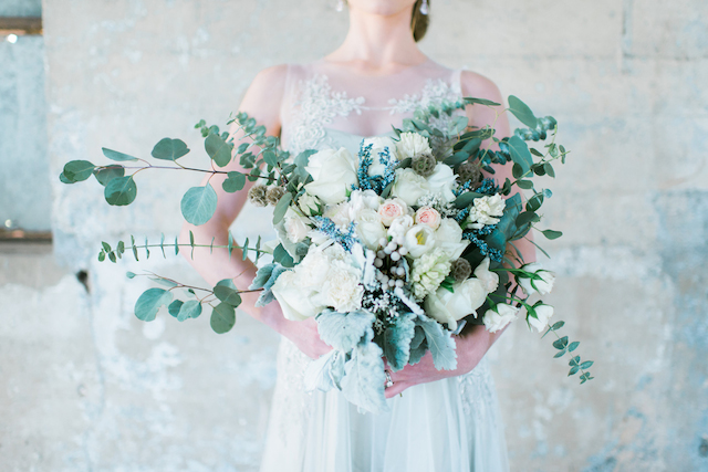 Asymmetrical bridal bouquet | Elisheva Golani Photography and Belle Soul Weddings | see more on: http://burnettsboards.com/2015/05/romantic-dusty-blue-wedding/