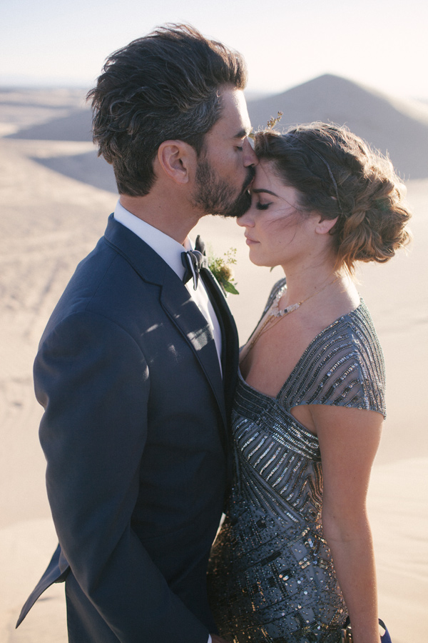 bride and groom in blue - photo by Ashley Williams Photography http://ruffledblog.com/california-sand-dunes-wedding