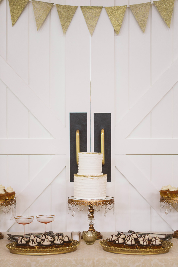 gold glam cake table - photo by A Muse Photography http://ruffledblog.com/gold-glam-vineyard-wedding-in-virginia