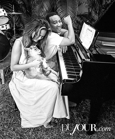 Legend tickles the ivories while Teigen cradles her new best friend, this adorable goat.
