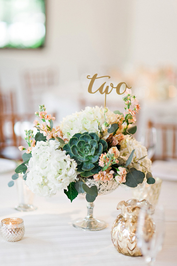 gold laser cut table numbers - photo by Pinkerton Photography http://ruffledblog.com/spring=romantic-wedding-in-the-desert