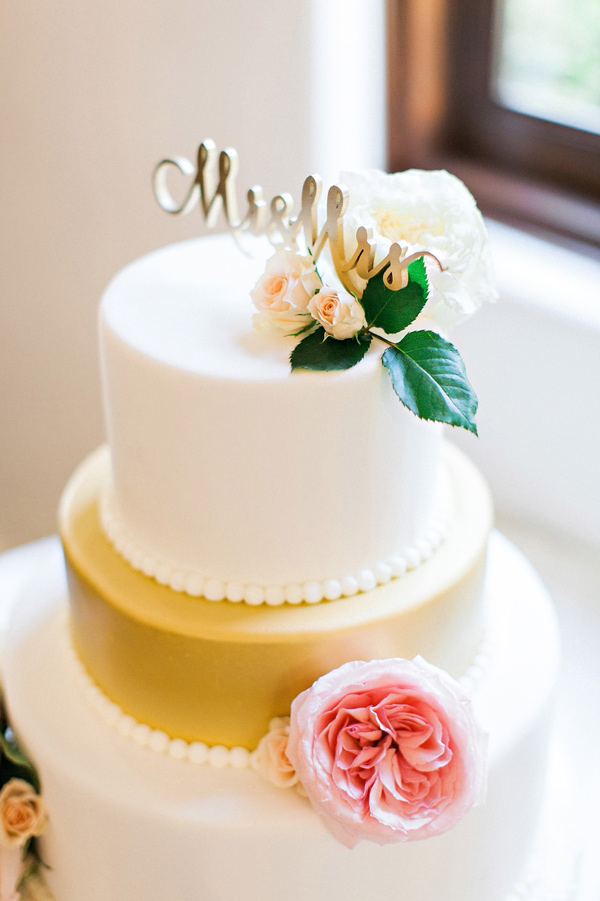 gold and white wedding cake - photo by Pinkerton Photography http://ruffledblog.com/spring=romantic-wedding-in-the-desert