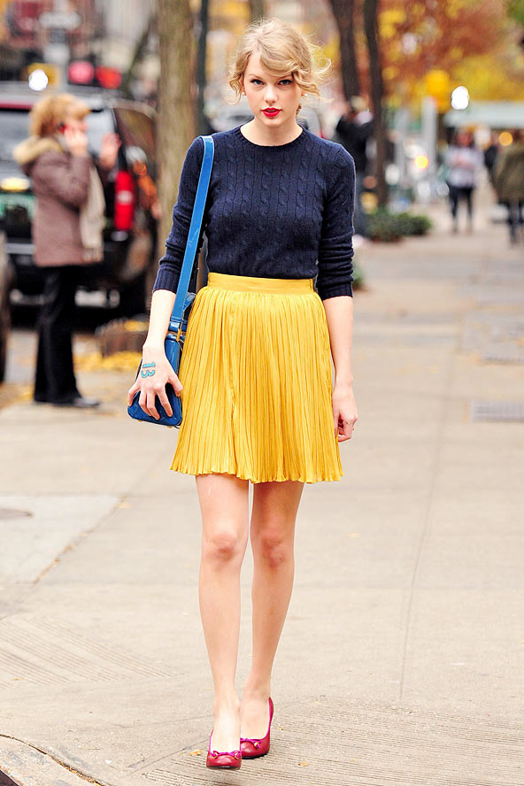 yellow pleated skirt and blue top preppy