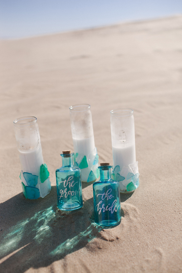 wedding decor with sea glass - photo by Ashley Williams Photography http://ruffledblog.com/california-sand-dunes-wedding