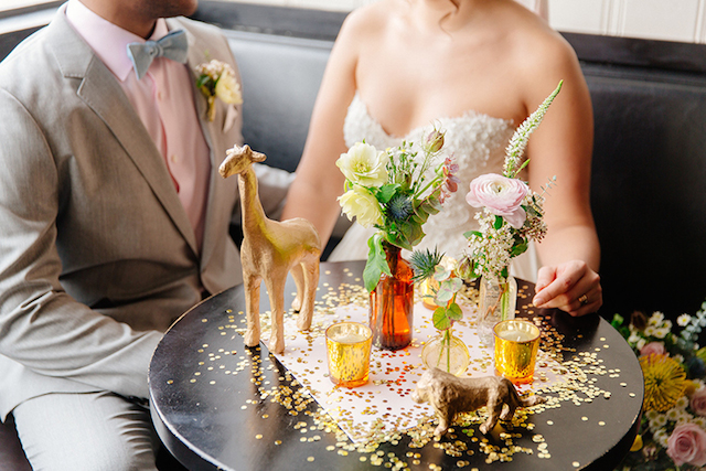 Gold painted animals and confetti table | The Melideos + Kerry Ann Stokes | see more on: http://burnettsboards.com/2015/06/vintage-coney-island-wedding/