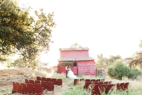 barn wedding ceremony - photo by Sposto Photography http://ruffledblog.com/countryside-wedding-with-cobalt-blue-and-crimson