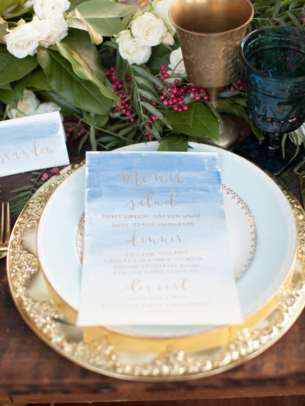 blue watercolor menu - photo by Sposto Photography http://ruffledblog.com/countryside-wedding-with-cobalt-blue-and-crimson