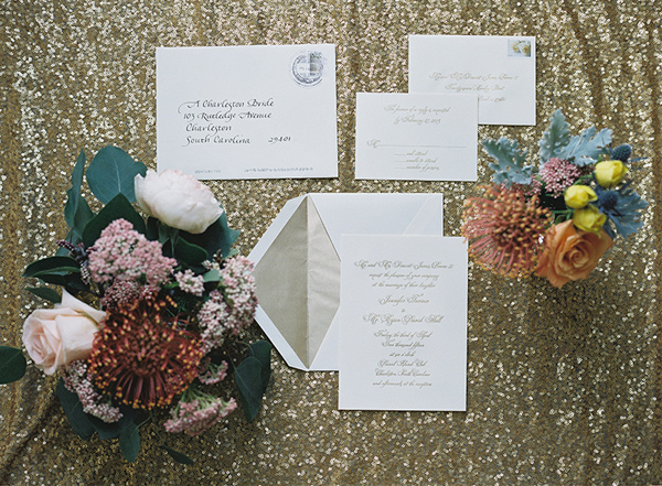 gold and ivory wedding invitations - photo by Virgil Bunao http://ruffledblog.com/charleston-wedding-with-loads-of-bright-colors