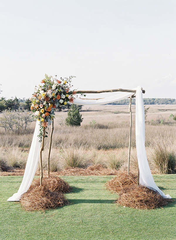 wedding ceremony arch - photo by Virgil Bunao http://ruffledblog.com/charleston-wedding-with-loads-of-bright-colors