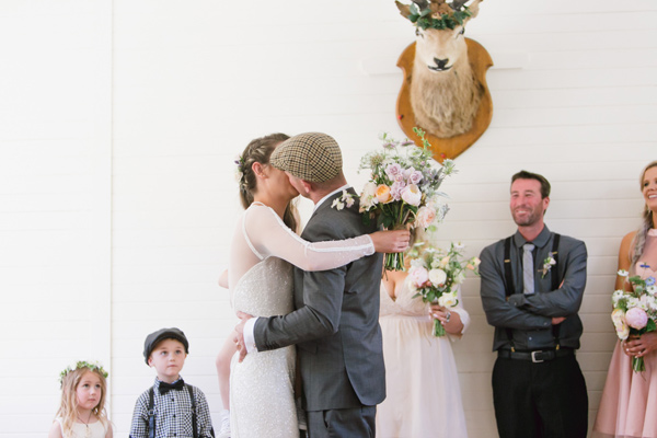 ceremony kiss - photo by Courtney Horwood Photography http://ruffledblog.com/modern-barn-wedding-in-new-zealand