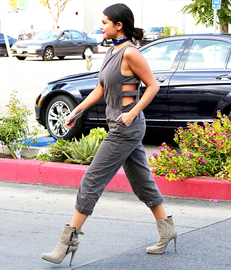Selena Gomez sizzles en route to Jamba Juice wearing a cutout one-piece and quilted booties.