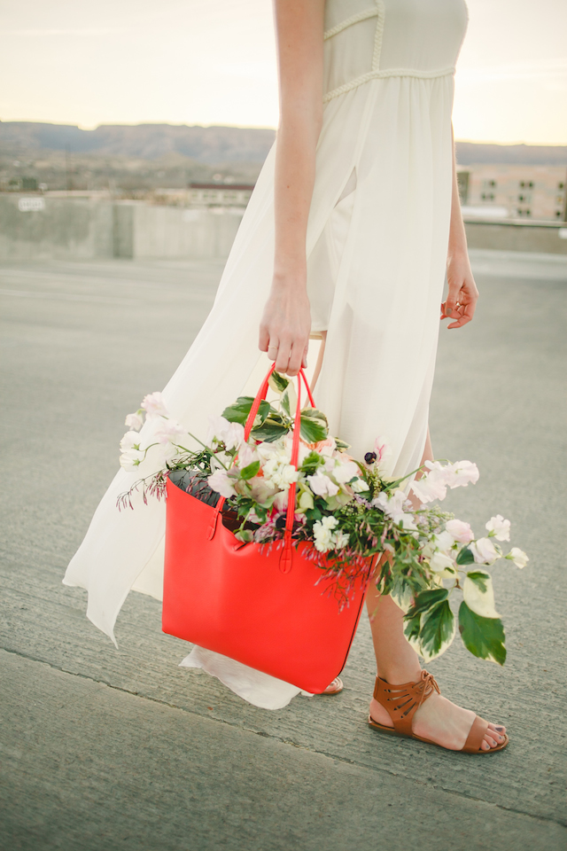 Flowers in purse | K Robinson Photography | see more on: http://burnettsboards.com/2015/06/urban-boho-bridals/