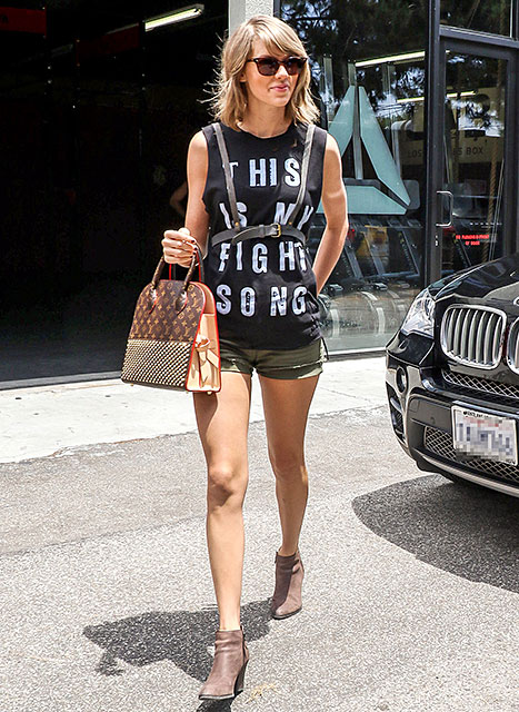 Taylor Swift wears a harness out to lunch with Selena Gomez on June 16.