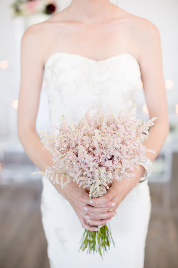 blush pink bouquet - photo by Amy and Jordan Photography http://ruffledblog.com/modern-silver-and-purple-wedding-editorial