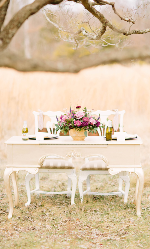 rustic reception table - photo by Erika Lynn Photography http://ruffledblog.com/berry-toned-spring-wedding-editorial