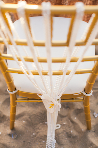 Pearl and orchid chair decorations | Denise Lin Photography | see more on: http://burnettsboards.com/2015/06/beach-sweetheart-table/