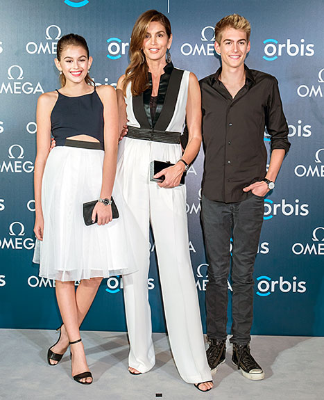 Cindy Crawford poses with her daughter Kaia Gerber, and son Presley Gerber as they attend 'The Hospital In The Sky' Asian premiere presented by OMEGA on June 16, 2015.