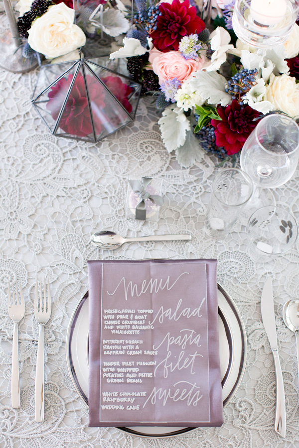 silver and mauve place setting - photo by Amy and Jordan Photography http://ruffledblog.com/modern-silver-and-purple-wedding-editorial