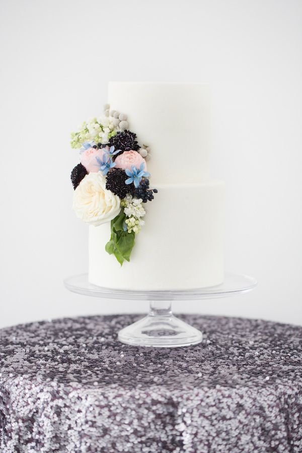 white cake with flowers - photo by Amy and Jordan Photography http://ruffledblog.com/modern-silver-and-purple-wedding-editorial