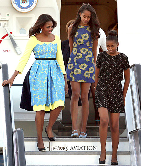Lady Michelle Obama arrives with daughters Malia and Sasha at Stanstead airport on June 15, 2015 in London, England.
