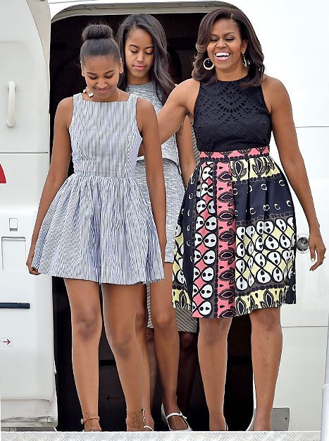 Lady Michelle Obama arrives with daughters Malia and Sasha at Malpensa Airport on June 17, 2015 in Milan, Italy.