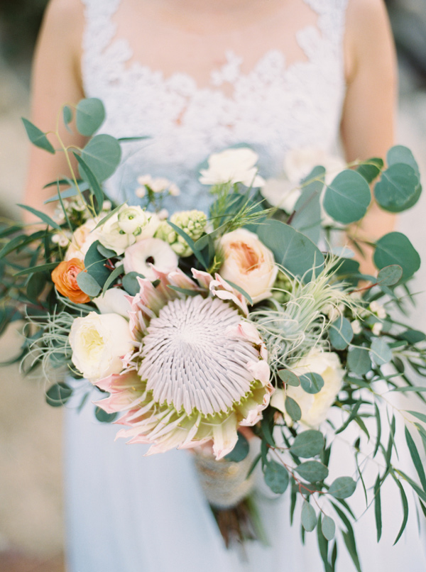 Protea bouquet - photo by Laura Goldenberger http://ruffledblog.com/palm-springs-wedding-for-a-creative-bride-and-groom