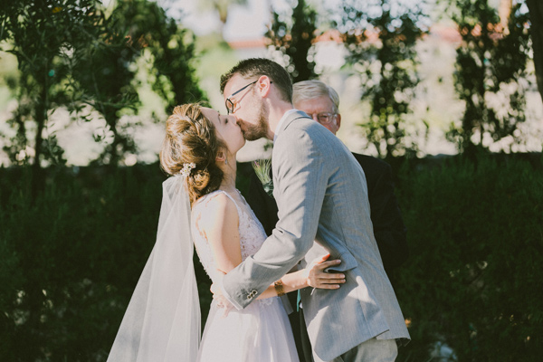 ceremony kiss - photo by Laura Goldenberger http://ruffledblog.com/palm-springs-wedding-for-a-creative-bride-and-groom