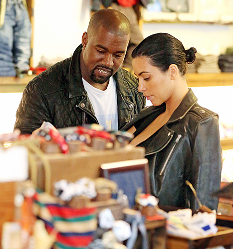 Kanye West smiles when shopping for baby clothes with Kim Kardashian at Trico Fields in NYC.