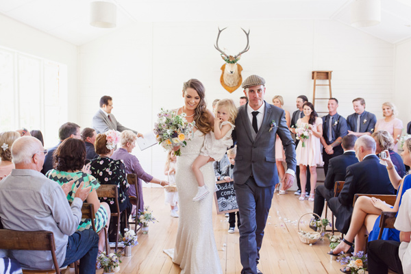 ceremony recessional - photo by Courtney Horwood Photography http://ruffledblog.com/modern-barn-wedding-in-new-zealand