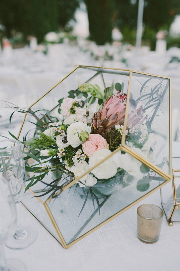 glass geometric centerpieces - photo by Laura Goldenberger http://ruffledblog.com/palm-springs-wedding-for-a-creative-bride-and-groom