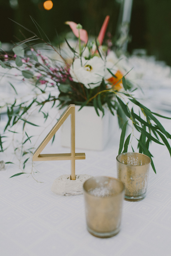 gold table numbers - photo by Laura Goldenberger http://ruffledblog.com/palm-springs-wedding-for-a-creative-bride-and-groom