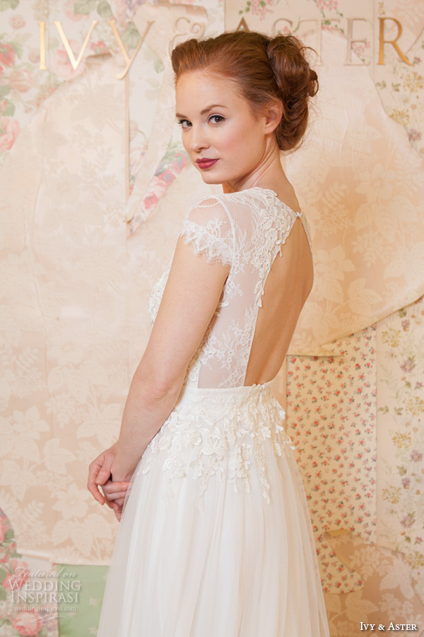ivy and aster spring 2016 bridal jewel neckline cap sleeves floral leaf lace top tulle a line skirt wedding dress closeup