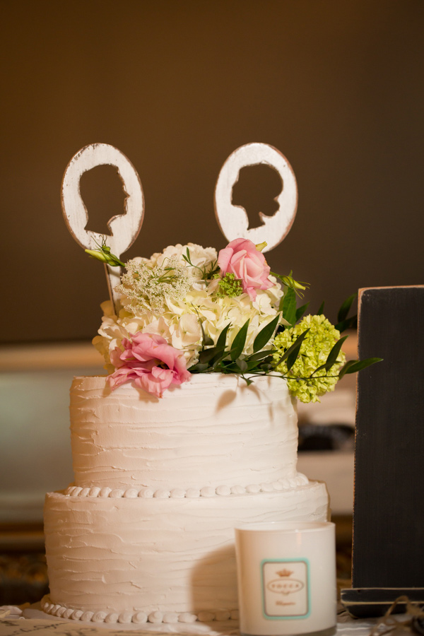 silhouette cake topper - photo by Shutter Sweet Photography http://ruffledblog.com/west-coast-foliage-wedding-in-charleston