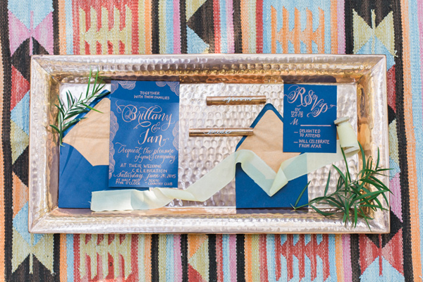 cobalt wedding invitations - photo by Olivia Richards Photography http://ruffledblog.com/natural-woodsy-and-copper-wedding-inspiration