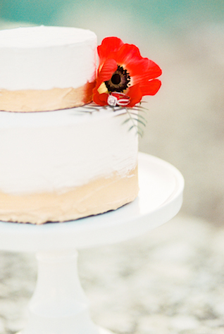 Gold and white wedding cake with red poppy | Callie Manion Photography | see more on: http://burnettsboards.com/2015/07/retro-glam-bridals/