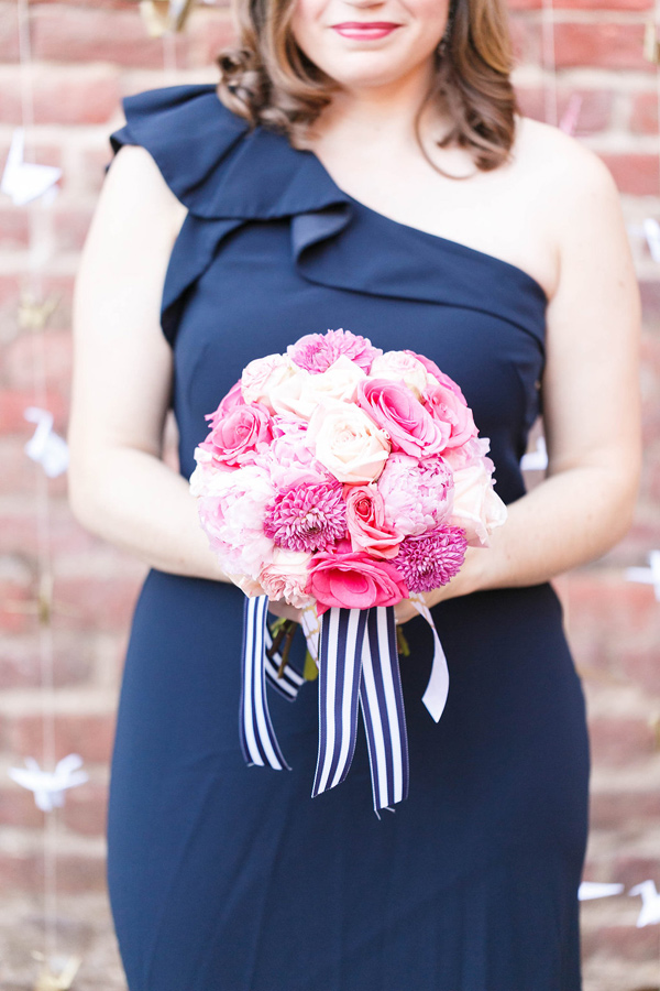 pink bouquet with striped ribbon - photo by VA Photography http://ruffledblog.com/handcrafted-real-vow-renewal